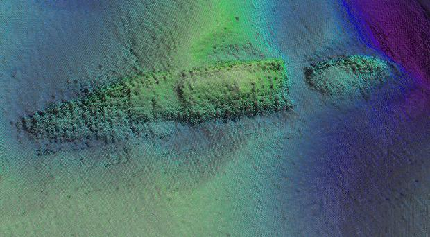 An image of the sea floor shows the partially buried wreck of the WM Barkley