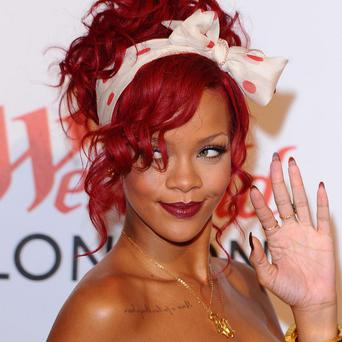 Rihanna says she's happy for Chris Brown
