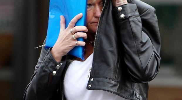 Julie Jones leaves Dudley Magistrates' Court where she has denied four charges brought under the Animal Welfare Act