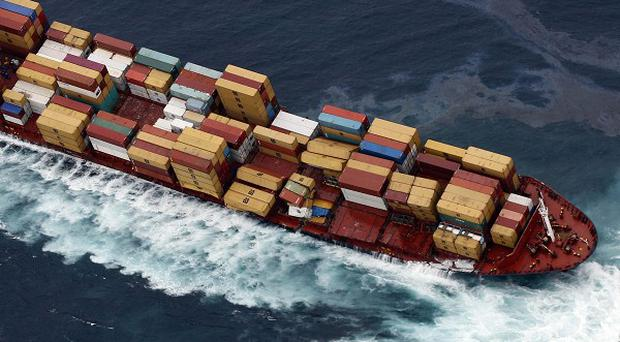 Container ship Rena stuck aground on a reef off the coast of Tauranga, New Zealand (AP)