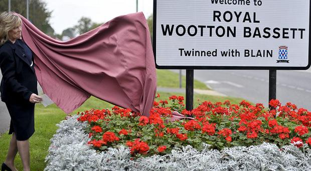 Wiltshire Council leader Jane Scott reveals the new sign for Royal Wootton Bassett
