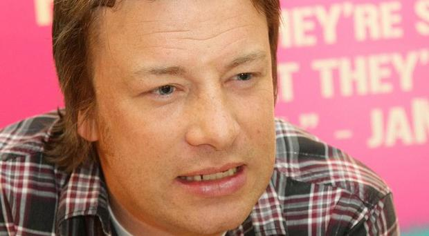 Jamie Oliver has slammed the Government's new anti-obesity strategy, saying eight-year-olds could come up with a better solution