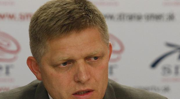 Opposition leader Robert Fico made a deal to back the euro bailout in exchange for early general elections on March 10 (AP)