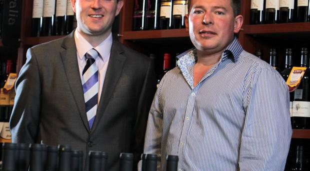 Northern Ireland retailer Kenny's Group has announced a new investment. Allen Reid of Ulster Bank (left) joins group owner Kenny Bradley to toast the future success of his new online wine delivery company