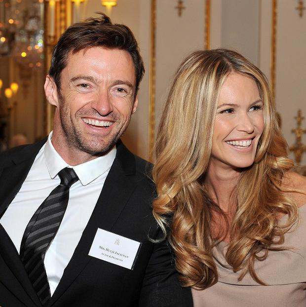Hugh Jackman said he was always happy to stand beside Elle Macpherson