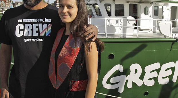 Greenpeace director Kumi Naidoo, left, and climate campaigner Melina Laboucan Massimo pose beside the new Rainbow Warrior (AP)