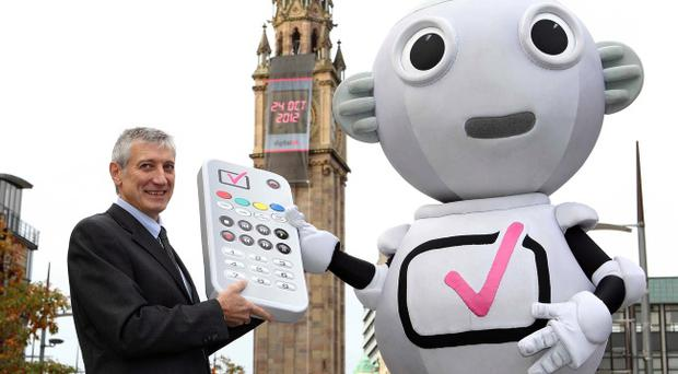 Robot Digit Al and Denis Wolinski, National Manager of Digital UK in Northern Ireland, turn the Albert Clock digital to reveal the date of the digital switchover in Northern Ireland, 24 October 2012