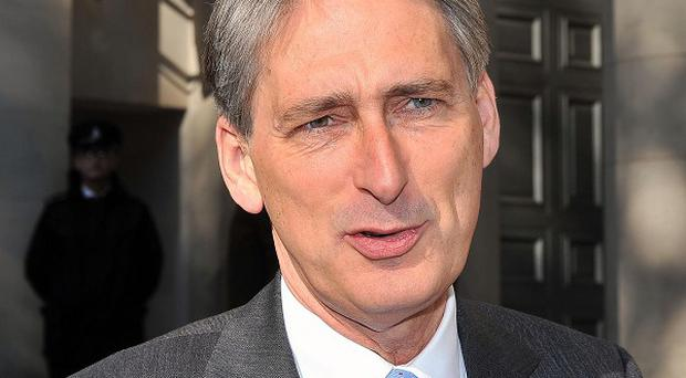 New Defence Secretary Philip Hammond arrives at the Ministry of Defence to begin his new role