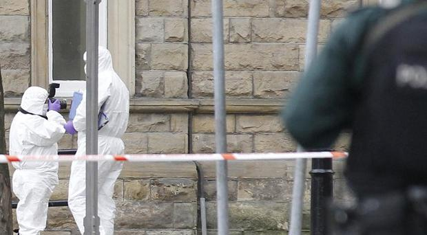Police forensic officers at the scene of a bomb attack in Londonderry