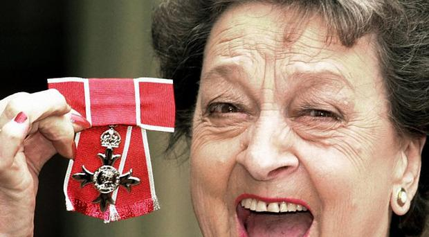 Betty Driver, pictured in 2000 as she received her OBE at Buckingham Palace, has died aged 91