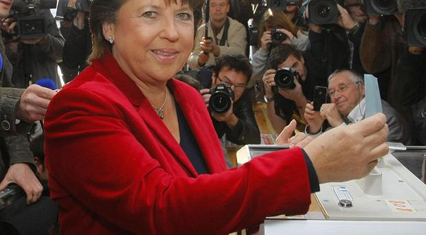 French Socialist Martine Aubry casts her vote for the second round of primary elections for the party (AP)