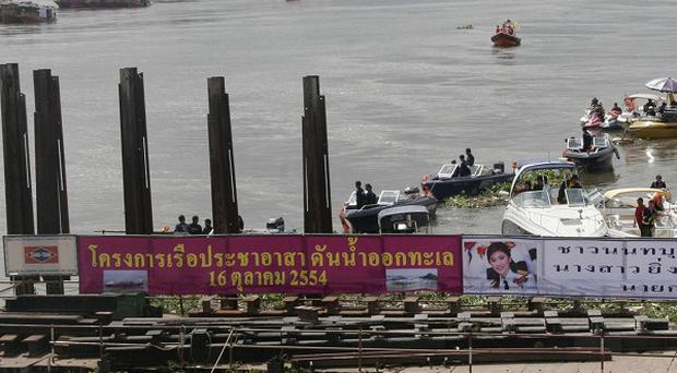 Motorboats are helping propel water from the Chao Phraya river into the Gulf of Thailand in Nonthaburi province (AP)
