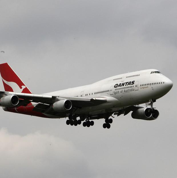 A Qantas Boeing 747 had to turn back after one its engines malfunctioned