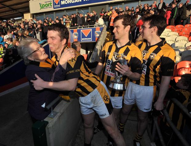 Crossmaglen captain Stephen Kernan gets a hug from Margaret McConville, mother of Oisin at Sunday's Armagh senior final in the Athletic Grounds, Armagh