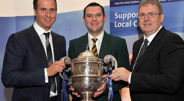 Peter Shields of North Down receives the NCU Premiership trophy from former England captain Michael Vaughan and Ulster Bank senior executive Stephen Cruise