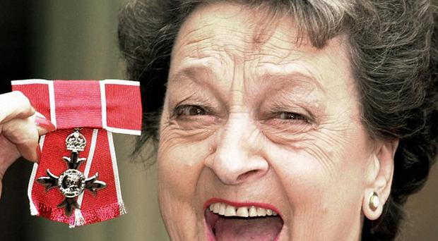 Betty Driver, pictured receiving her OBE in 2000, has died aged 91