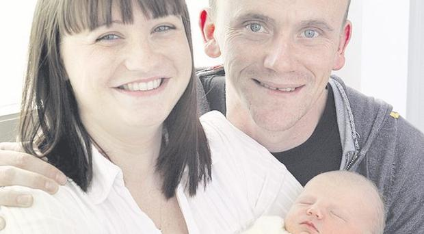 Amanda Davidson and John McKibben with baby Molly <p><b>To send us your Baby Pics <a href=