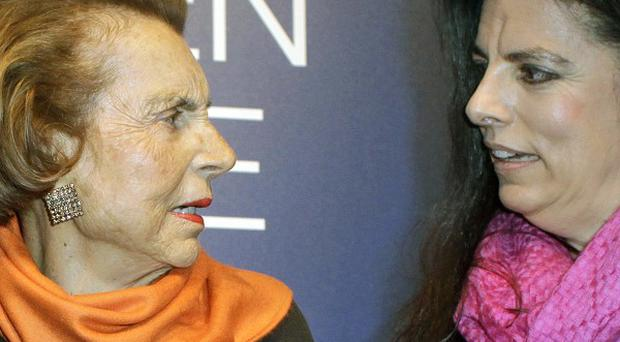L'Oreal heiress Liliane Bettencourt, left, and her daughter Francoise Meyers-Bettencourt who has been given legal care of her mother during a row over the family's fortune(AP)
