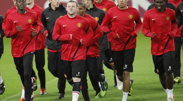 controversial United striker Wayne Rooney, who will start tonight's game, during training in Romania last night