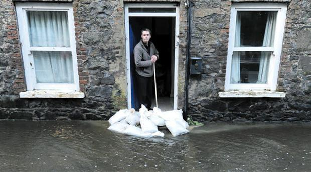 Mark McDonnell with sandbags outside his house in Antrim