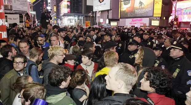 Occupy Wall Street protesters fill Times Square as part of rallies across the world (AP)
