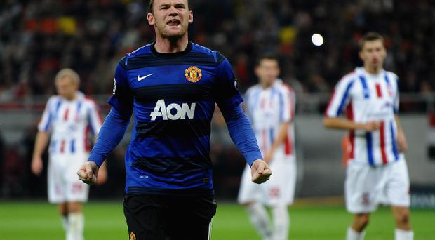 BUCHAREST, ROMANIA - OCTOBER 18: Wayne Rooney of Manchester United celebrates scoring from the penalty spot during the UEFA Champions League Group C match between FC Otelul Galati and Manchester United at the National Stadium on October 18, 2011 in Bucharest, Romania. (Photo by Laurence Griffiths/Getty Images)