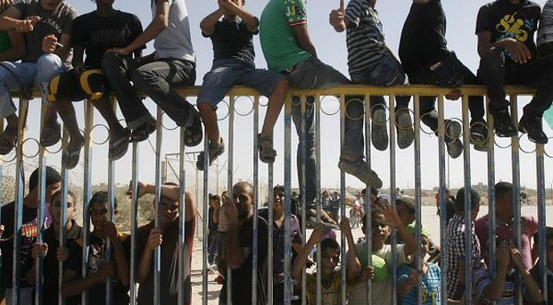 Palestinian youths celebrate the release of prisoners at the Rafah border crossing in southern Gaza Strip(AP)