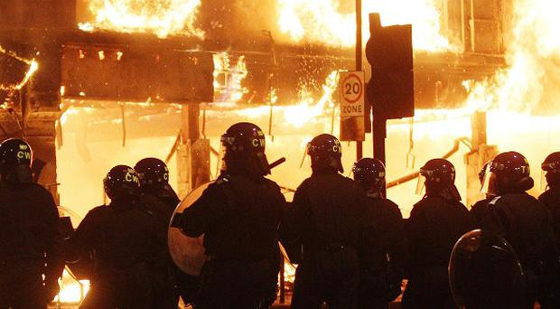 A primary school worker who took part in looting during the London riots has been jailed