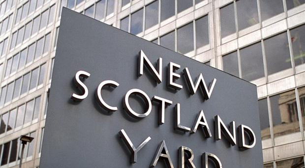 Scotland Yard faces a huge compensation claim after two detectives jailed on the word of supergrasses walked free