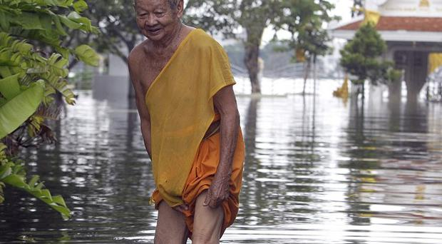 A desperate battle to prevent flood waters from destroying Bangkok is underway (AP)