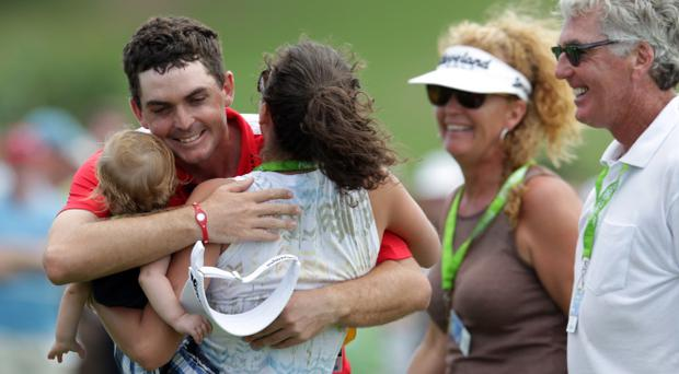 Keegan Bradley celebrates with his family after the final putt during the second round of the PGA Grand Slam of Golf in Bermuda
