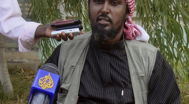 A Cardiff man flew to Africa, fearful that his son was going to join the Islamist rebel group al-Shabab, whose spokesperson Ali Mohamud Rage is pictured (AP)