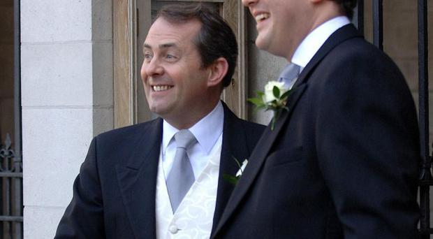 Former defence secretary Liam Fox resigned amid controversy over his links with Adam Werritty, right