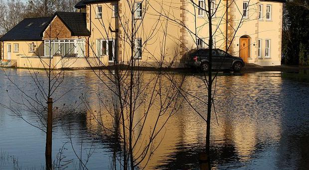 Future generations could be trapped in areas prone to flooding, a report has warned