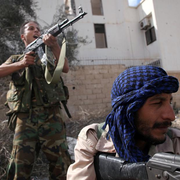 Anti-Gaddafi forces in action in Sirte (AP)