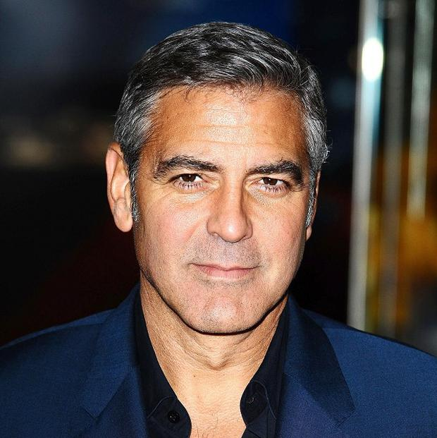 George Clooney arrives at the premiere of The Ides Of March