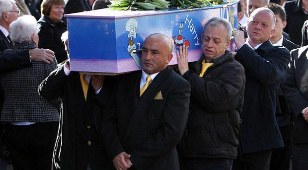 The funeral procession of Harry Moseley arrives at St Edburgha's Church in Yardley, Birmingham (PA)