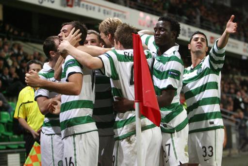 Celtic's Joe Ledley celebrates with team mates after scoring during the Europa League Group I qualifying soccer match against Rennes