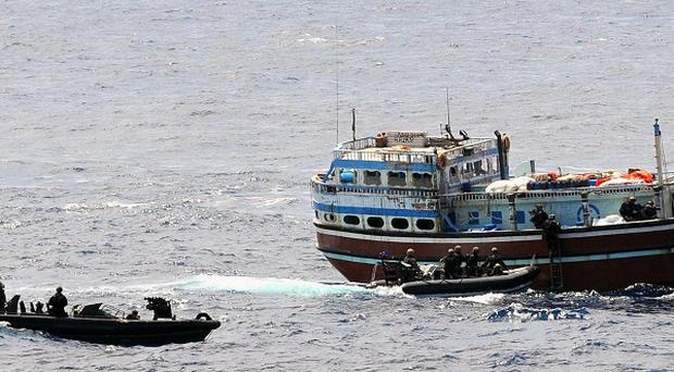 Ministry of Defence undated handout photo of a dhow, believed to be the mother ship of the pirate group that failed to take the MV Montecristo, RFA Fort Victoria, being secured by Royal Marines from HMS Somerset in the Indian Ocean. PRESS ASSOCIATION Photo. Picture date: Friday October 14, 2011. It is believed the dhow was hijacked by suspected pirates so that they could use it as a base, or mothership, from which to launch attacks against merchant ships many hundreds of miles from Somalia. Throughout this time, the Pakistani crew of the dhow was held hostage on board. HMS Somerset is currently assigned to the Combined Maritime Forces counter-piracy mission, Combined Task Force (CTF) 151. The dhow's crew of 20 were free to go on their way once the evidence gathering had finished. The four suspected pirates that were apprehended, however, have been passed to Italian authorities, on suspicion of their involvement in the attack on the MV Monte Cristo three days earlier. See PA story DEFENCE Pirates. Photo credit should read: LA(PHOT) Dave Jenkins/PA Wire NOTE TO EDITORS: This handout photo may only be used in for editorial reporting purposes for the contemporaneous illustration of events, things or the people in the image or facts mentioned in the caption. Reuse of the picture may require further permission from the copyright holder.