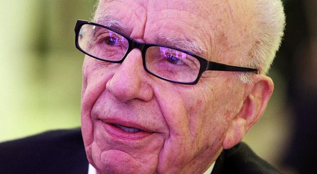 Rupert Murdoch will face News Corp shareholders at a meeting in Los Angeles