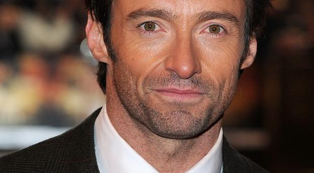 Hugh Jackman says he still doesn't have the movie pulling power of Brad Pitt or Will Smith