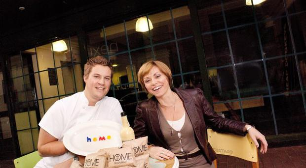 Andy Rea from the Mourne Seafood Bar and Jill O'Neill from ReFound get prepared for new Belfast pop-up restaurant Home