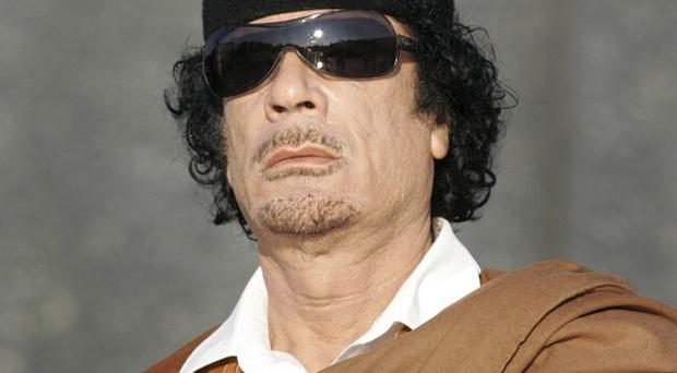 The Libyan transitional government says Muammar Gaddafi will be buried according to the Islamic tradition (AP)