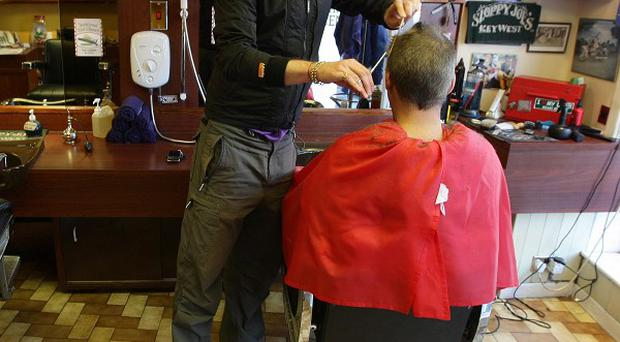 Households spent an average of almost 6,000 pounds last year on essentials such as haircuts