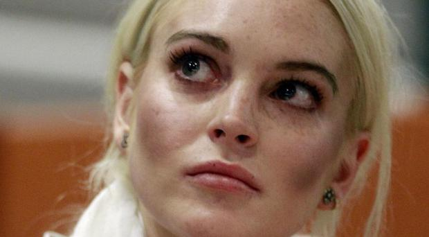 Lindsay Lohan was turned away from her first day of community service at a morgue (AP)