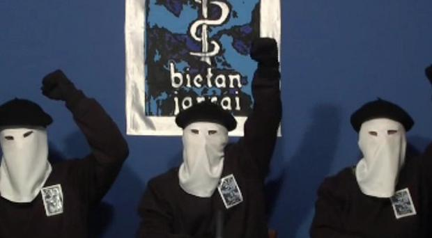 Masked members of the Basque militant group Eta call an end to a 43-year violent campaign for independence (AP)