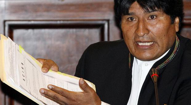Bolivian president Evo Morales has bowed to pressure to ditch plans to build a road through a nature reserve (AP)