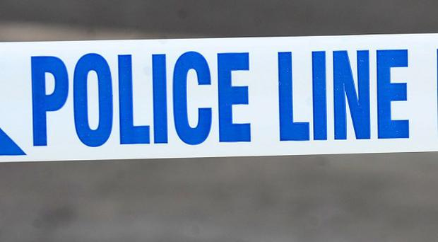 A man died during an incident at a block of flats in Ipswich