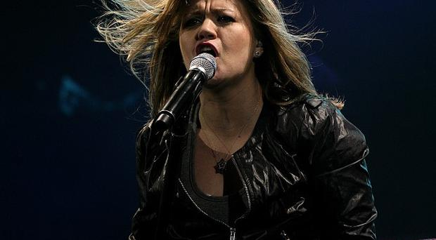 Kelly Clarkson is hoping the drama has come to an end