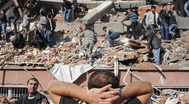 Rescuers try to save people trapped under debris in Turkey after a powerful earthquake struck (AP)
